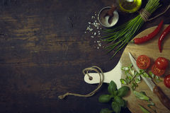 Knife, Cutting Board and Fresh Vegetables Royalty Free Stock Image