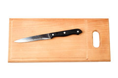 Knife on cutting board isolated Royalty Free Stock Images