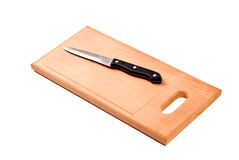 Knife on cutting board isolated Royalty Free Stock Photography