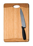 Knife on cutting board Stock Photography