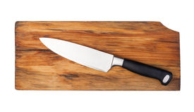 Knife on a cutting board. Isolated on white Stock Image