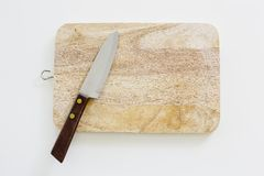 Knife and cutting board used in Japanese cuisine, in real life Royalty Free Stock Image