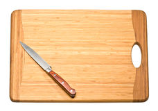 Knife on cutting board Royalty Free Stock Photo