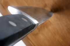 Knife in Cutting Board2 royalty free stock photo