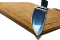 Knife On Cutting Board2 royalty free stock image