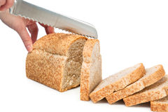Knife cutting bread Royalty Free Stock Image