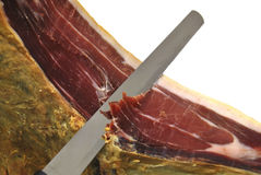Knife cutting ham Stock Images
