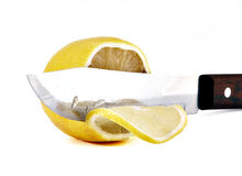 Knife a cutting juicy lemon Royalty Free Stock Images