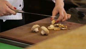 Knife cutting mushrooms stock video footage