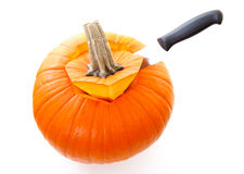 Knife is cutting in pumpkin Stock Photography