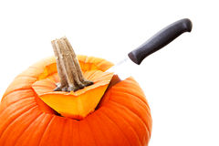 Knife is cutting in pumpkin Royalty Free Stock Photo