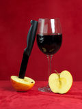 Knife cutting a red apple Stock Photo