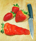 Knife cutting strawberry Stock Image