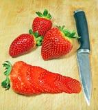 Knife cutting strawberry Stock Image
