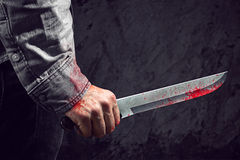 Knife. Dangerous killer with bloody knife Royalty Free Stock Images