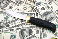 Knife and dollars Royalty Free Stock Photos