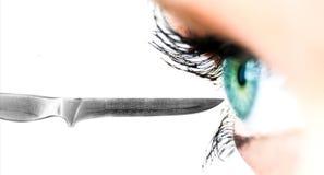 Knife and eye Stock Photos