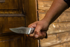 A knife in the fist,invador, raider, knife attack Stock Images