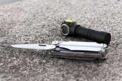 Knife and flashlight. Royalty Free Stock Photo