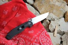 Knife folding Stock Images