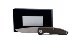 Knife. Folding knife on a white background with packing royalty free stock image