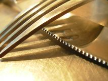Knife and Fork. Macro of Knife and Fork on my kitchen counter royalty free stock photo