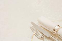 Knife and fork. With napkin and plate, on a tablecloth with copyspace Stock Photos