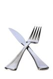 Knife and fork. Isolated against a white background Stock Photos