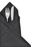 Knife and fork. Wrapped in a black napkin as a table setting and isolated on a white background stock images
