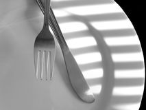 Knife and Fork. On a plate royalty free stock photo