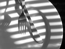 Knife and Fork. On a plate Stock Image