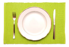 Knife, Fork And White Plate On A Green Napkin Royalty Free Stock Photography