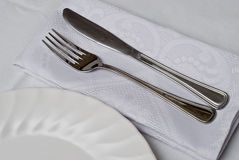 Knife and fork around the plate. Royalty Free Stock Image