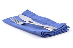Knife and fork on blue napkin Stock Photography