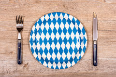 Knife and fork with blue and white plate Stock Images