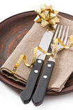 Knife and fork on ceramic plate Royalty Free Stock Photos