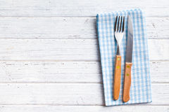Knife and fork on checkered napkin Stock Images
