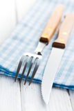 Knife and fork on checkered napkin Royalty Free Stock Photography
