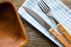Knife and fork on checkered napkin Royalty Free Stock Photo
