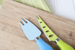 Knife and Fork on Chopping Block Stock Photography