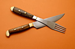 Knife and fork. Color background Spotlight Royalty Free Stock Images
