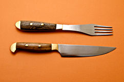 Knife and fork. Color background Spotlight Stock Images
