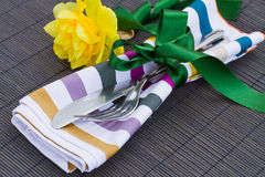 Cutlery serving with daffodil flower Royalty Free Stock Images