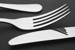 Knife and fork detail over a black background. Cutlery. Stock Image