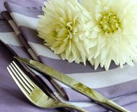 knife, fork and flowers on napkin Royalty Free Stock Image