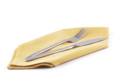 Knife and fork on gold napkin Royalty Free Stock Photos