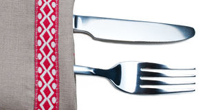 Knife and fork on gray napkin Stock Photos