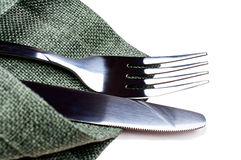 Knife and fork on green napkin Stock Photos