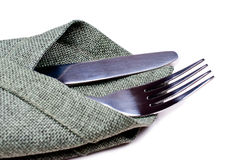 Knife and fork on green napkin close up Stock Photos