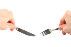 Knife and fork in hands. Isolated on white background royalty free stock image